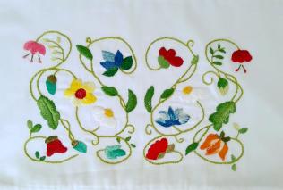 Almofa com flores da Florart.